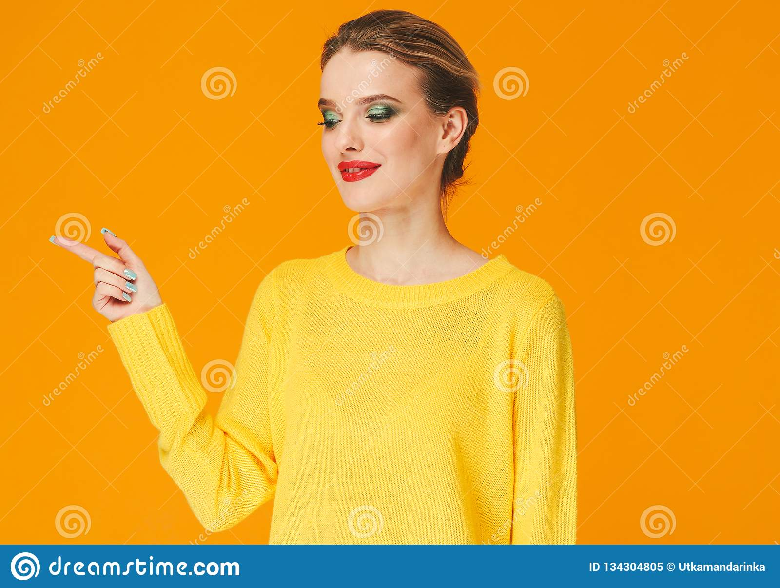 Colorful makeup woman red lips in yellow clothes on color happy summer fashion background manicured nails