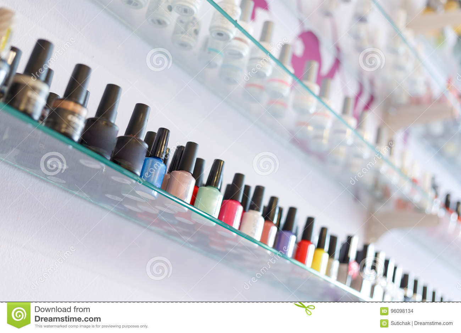 Colorful Manicure Nail Polish Bottle Collection Set On Shelf Stock ...