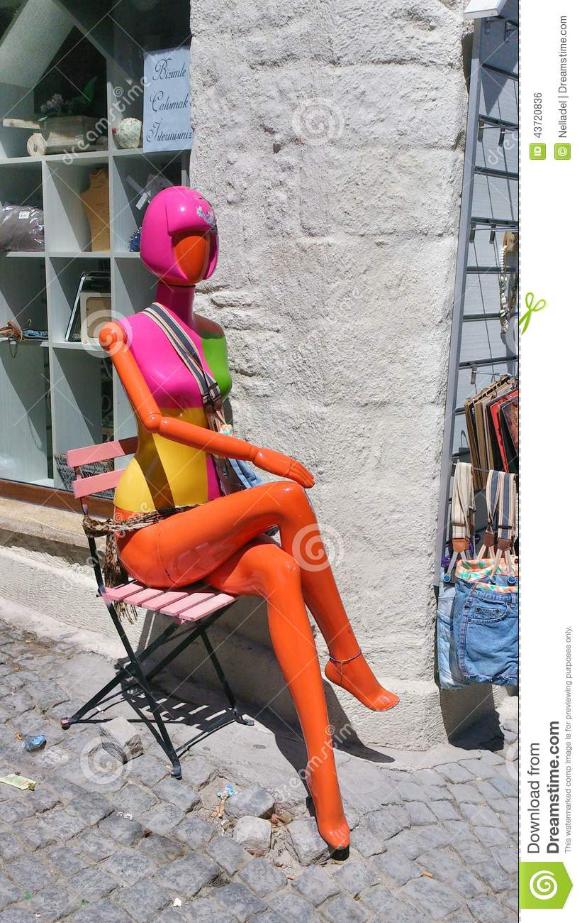 Green Orange Small Apartment Living Room Decor: Colorful Mannequin Editorial Photo