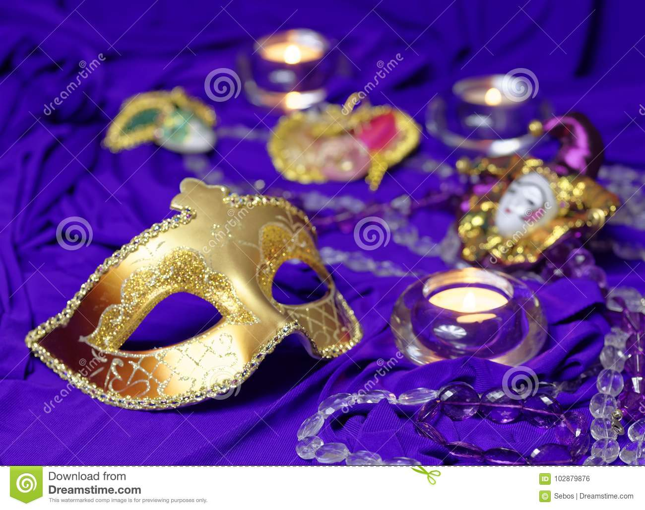 Colorful Mardi Gras or Carnival masks group on a purple background.