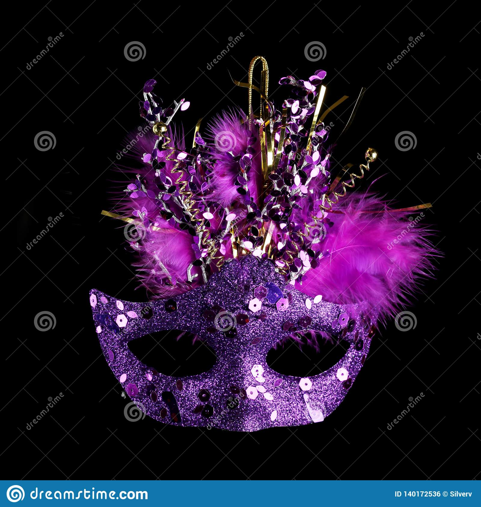 Colorful Mardi Gras mask isolated on black