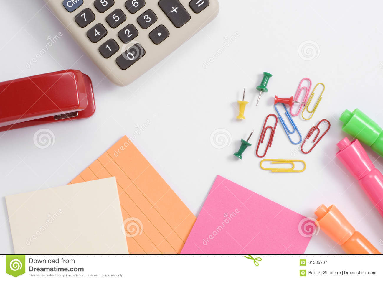 colorful office supplies with calculator and red stapler