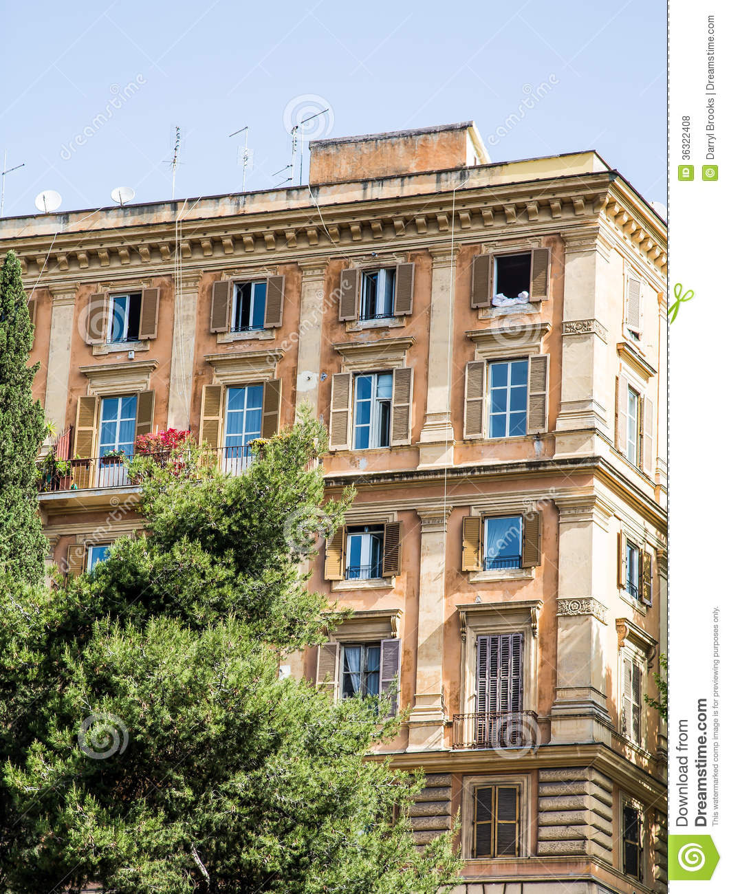 Old Apartment Building: Colorful Old Apartment Building In Rome Stock Photo