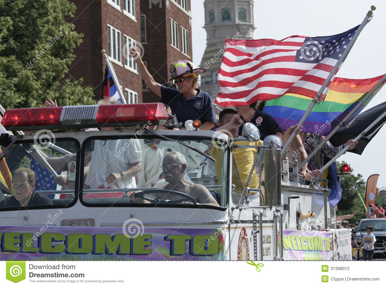 Colorful Old Decorated Firetruck with American and Rainbow Flags at Indy Pride