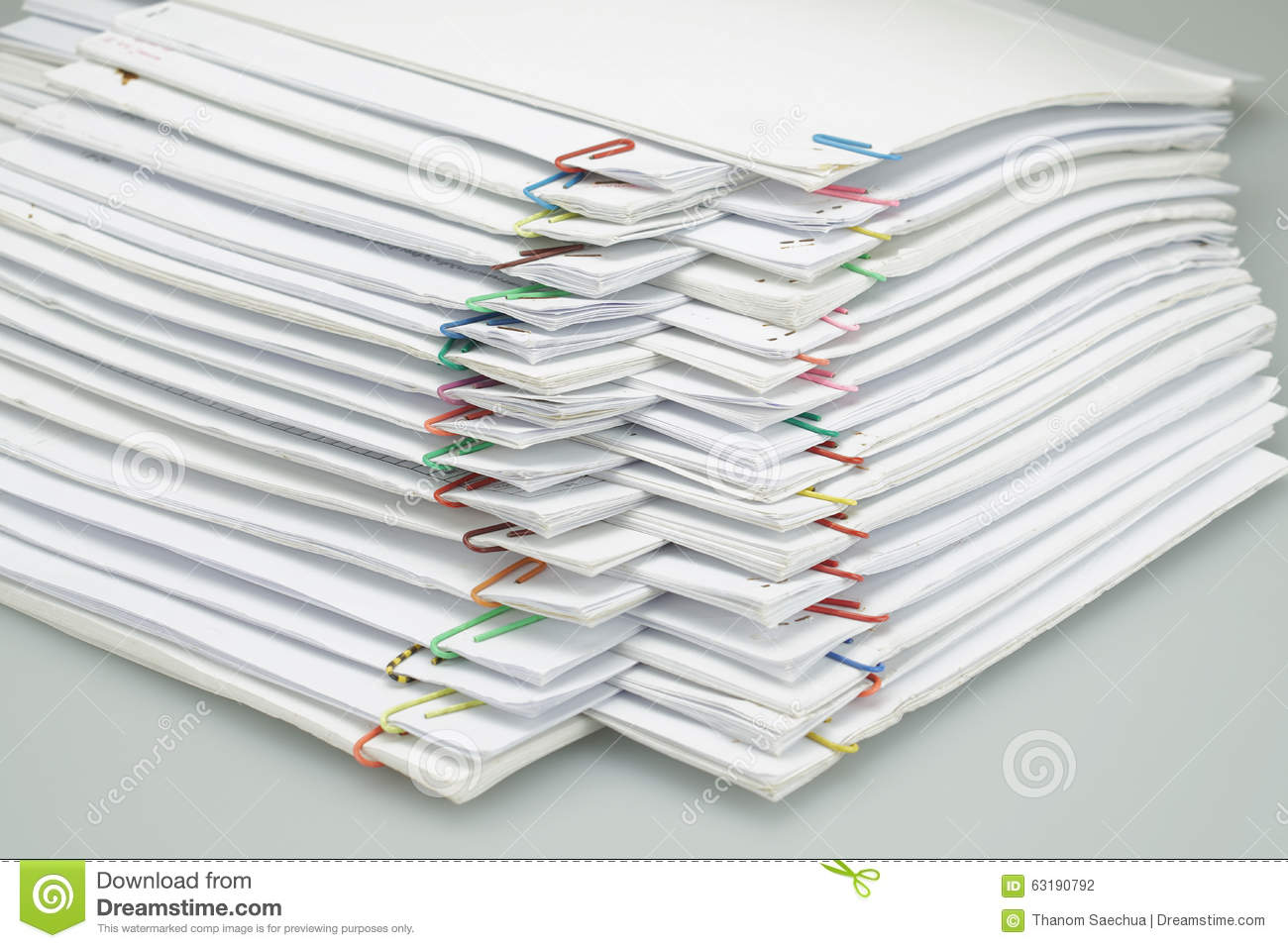 Colorful Paper Clip With Pile Of Paper Reports Arranged On Table ...