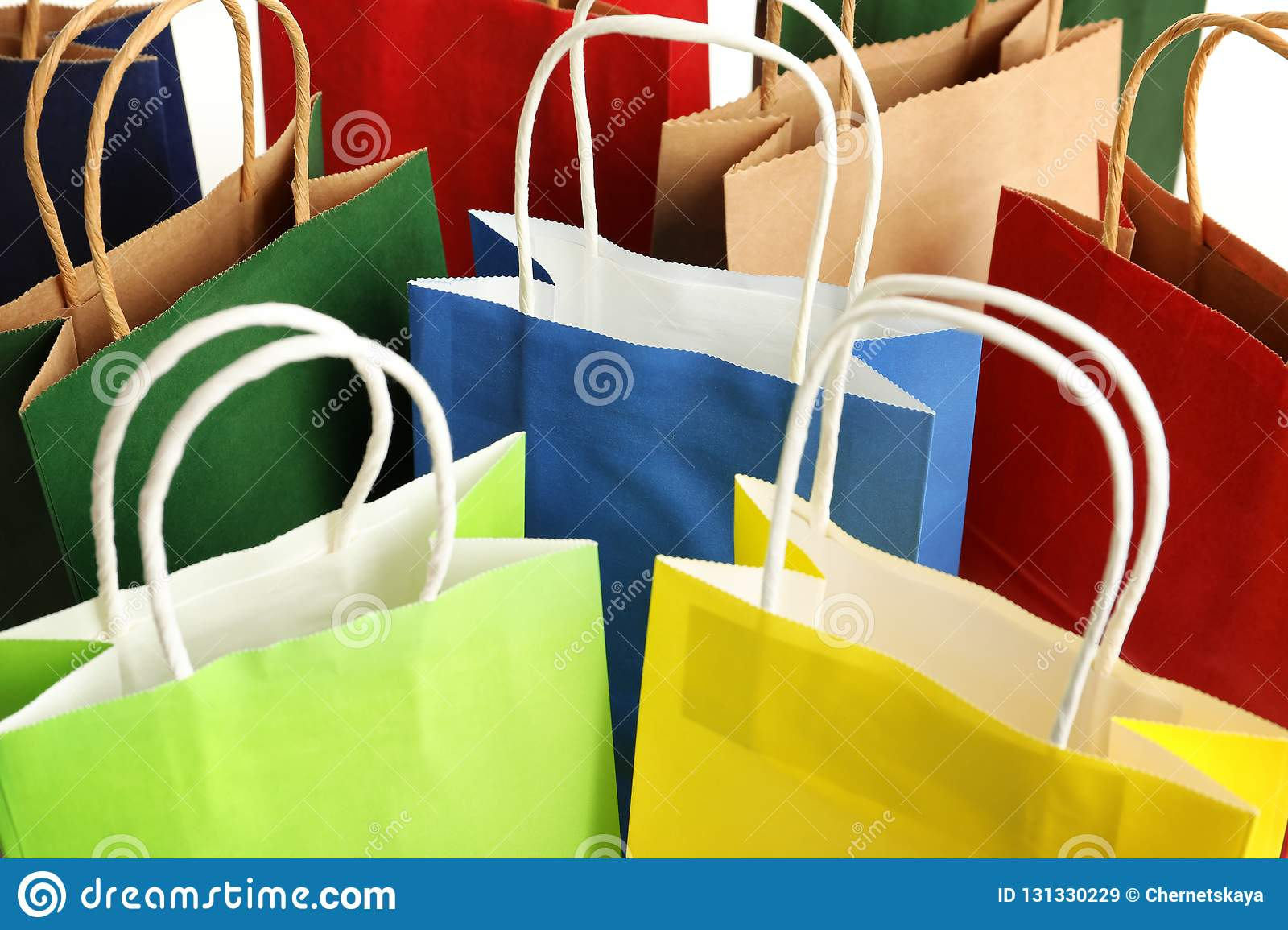 Colorful paper shopping bags as background