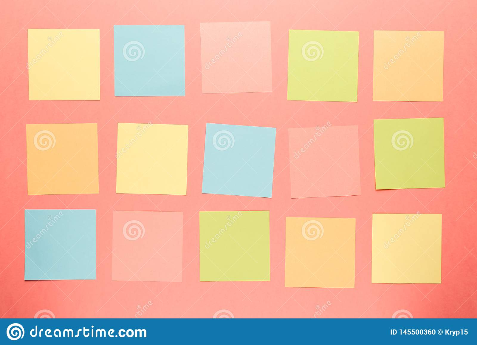 Colorful paper stickers on coral background