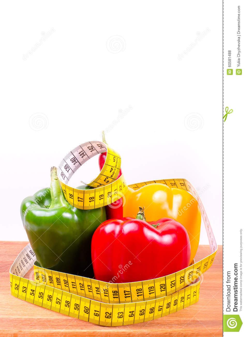 Colorful paprika and measuring tape, Diet concept