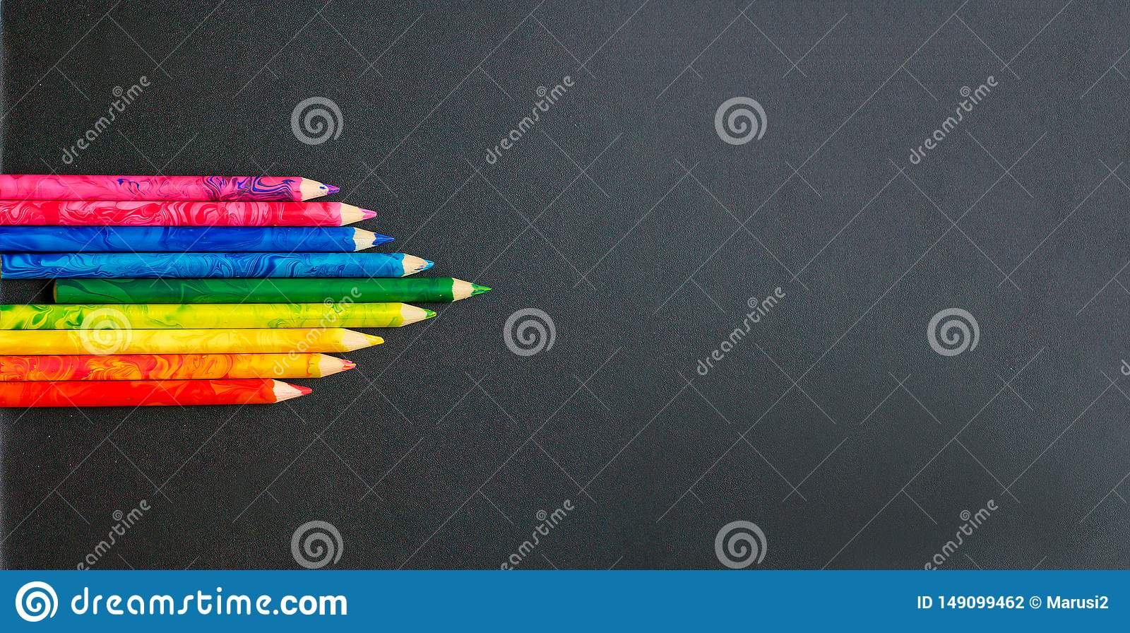 Colorful pencils on the school board