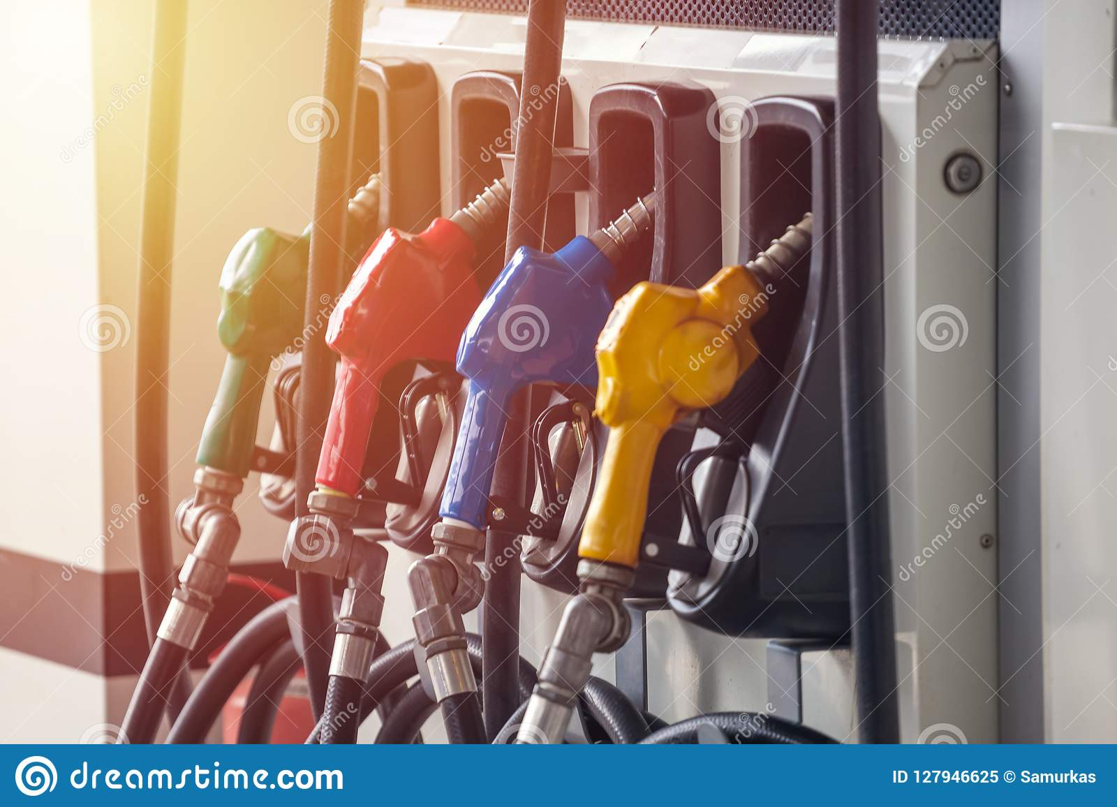 Colorful Petrol pump filling nozzles, Gas station in a service