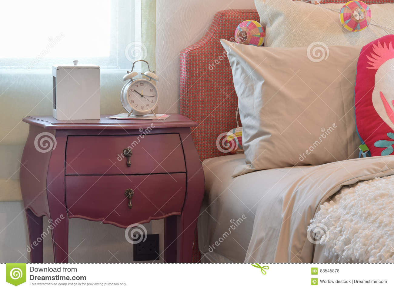 Colorful Pillows And Bedside Table Lamp In Modern Kid
