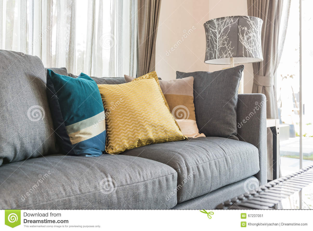 Colorful Pillows On Modern Grey Sofa In Living Room Stock Photo