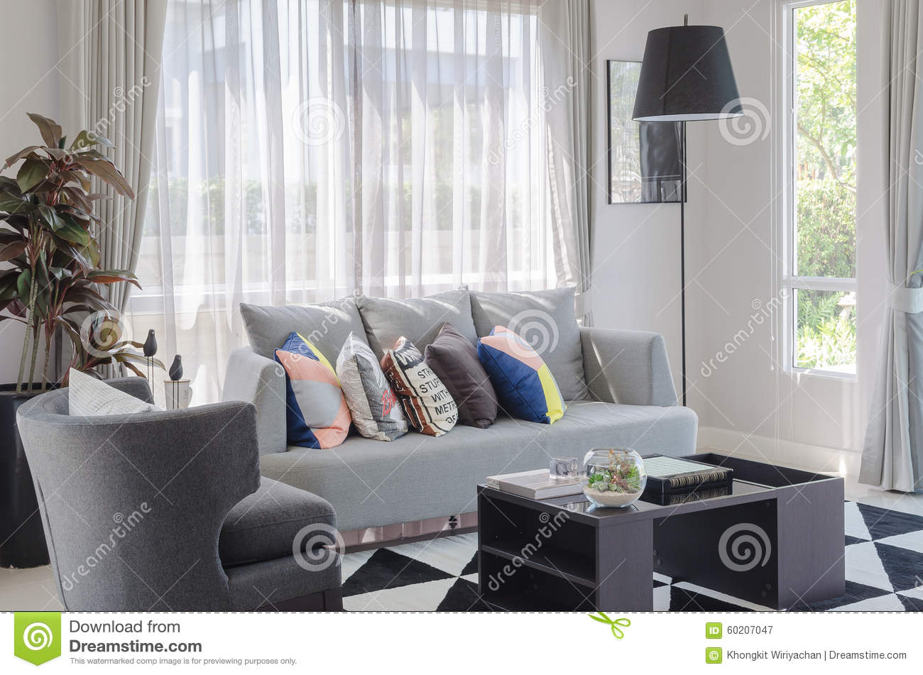 Colorful Pillows On Modern Grey Sofa In Living Room Stock