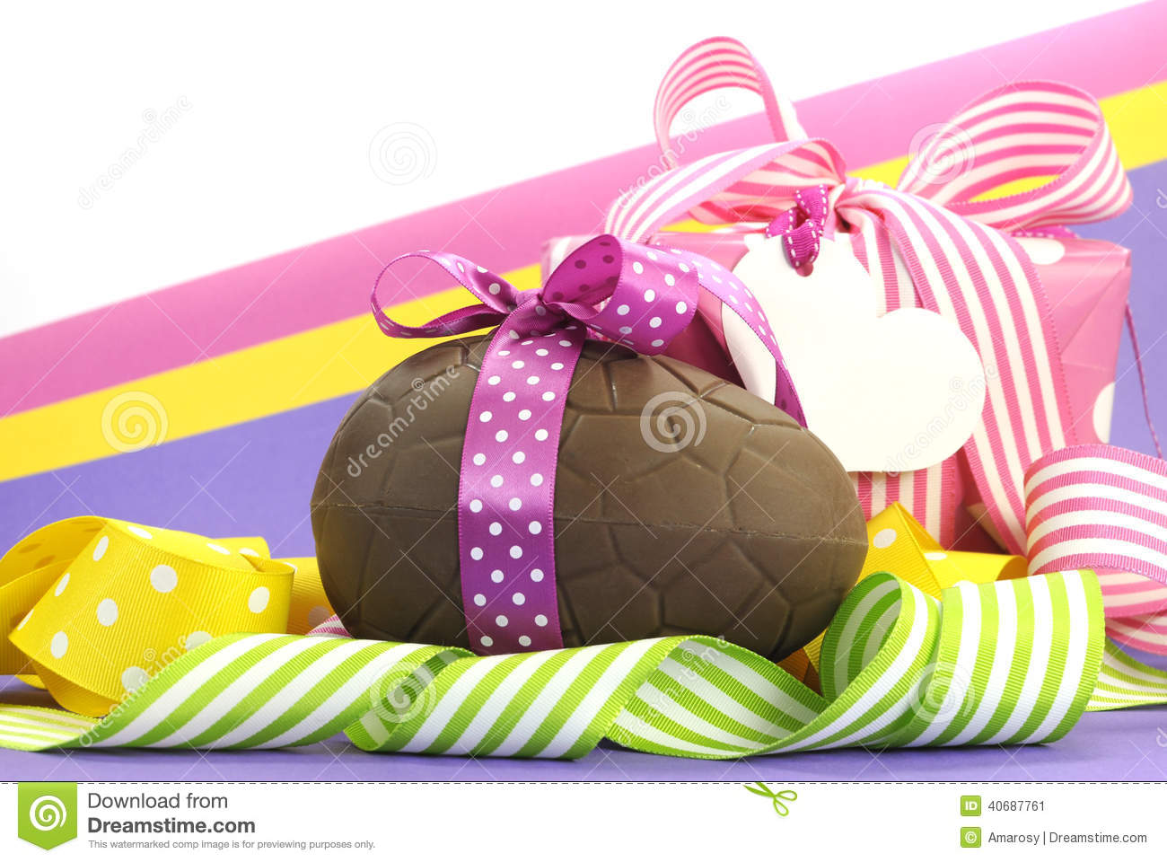 Yellow theme gift box with yellow polka dot ribbon stock image colorful pink yellow and purple theme happy easter theme with chocolate egg and gift box negle Choice Image