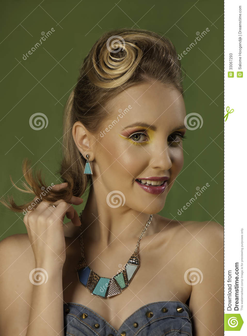 Colorful portrait of playful blonde girl in bright makeup