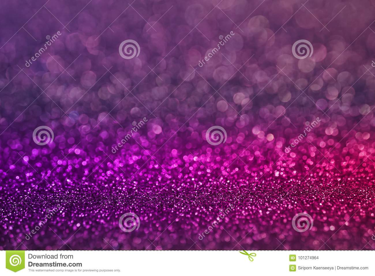 colorful purple pink bokeh light glitter background for christmas and new years day