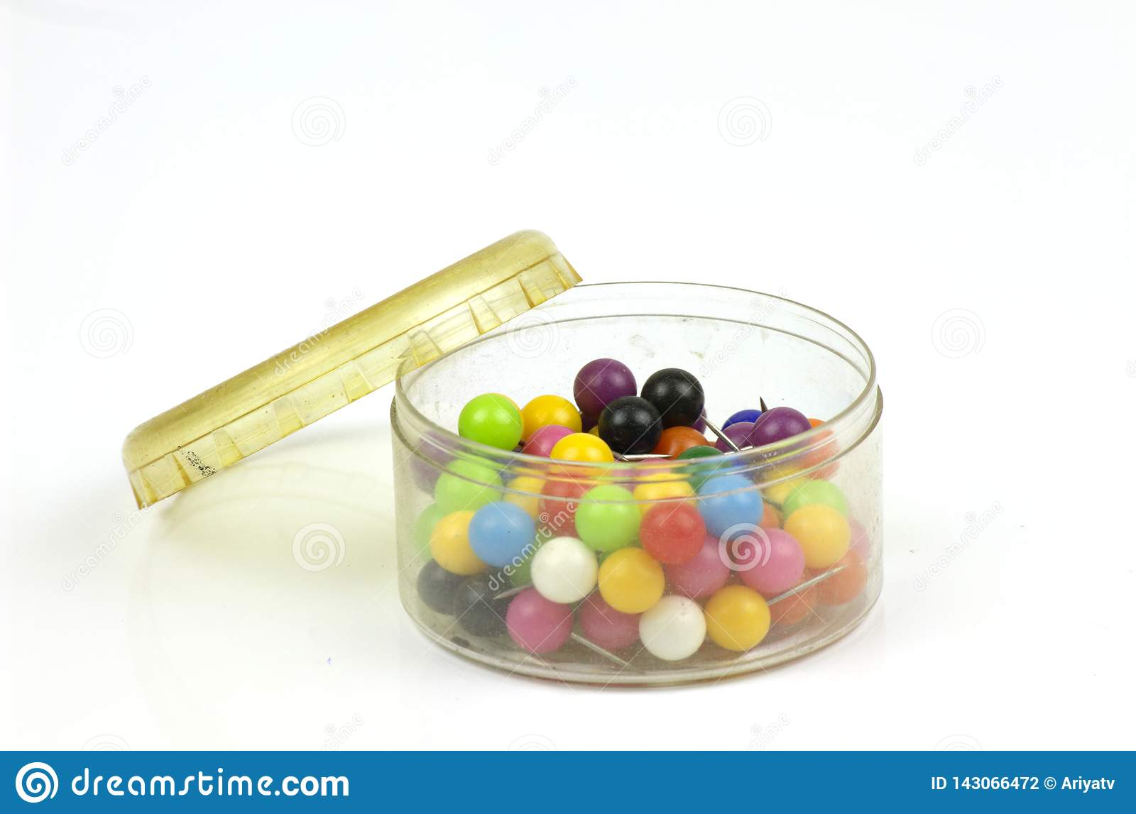 Colorful push pins on white background
