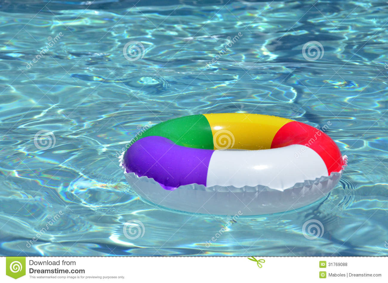 A Colorful Raft Floating In The Pool Royalty Free Stock