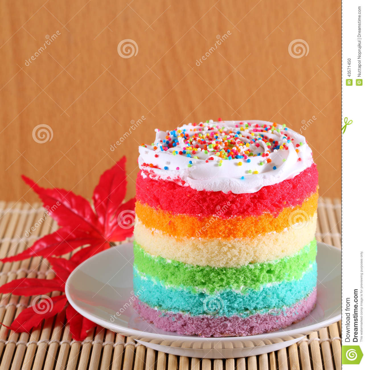 Colorful Rainbow Cakes On White Plate With Red Maple Leaf ...