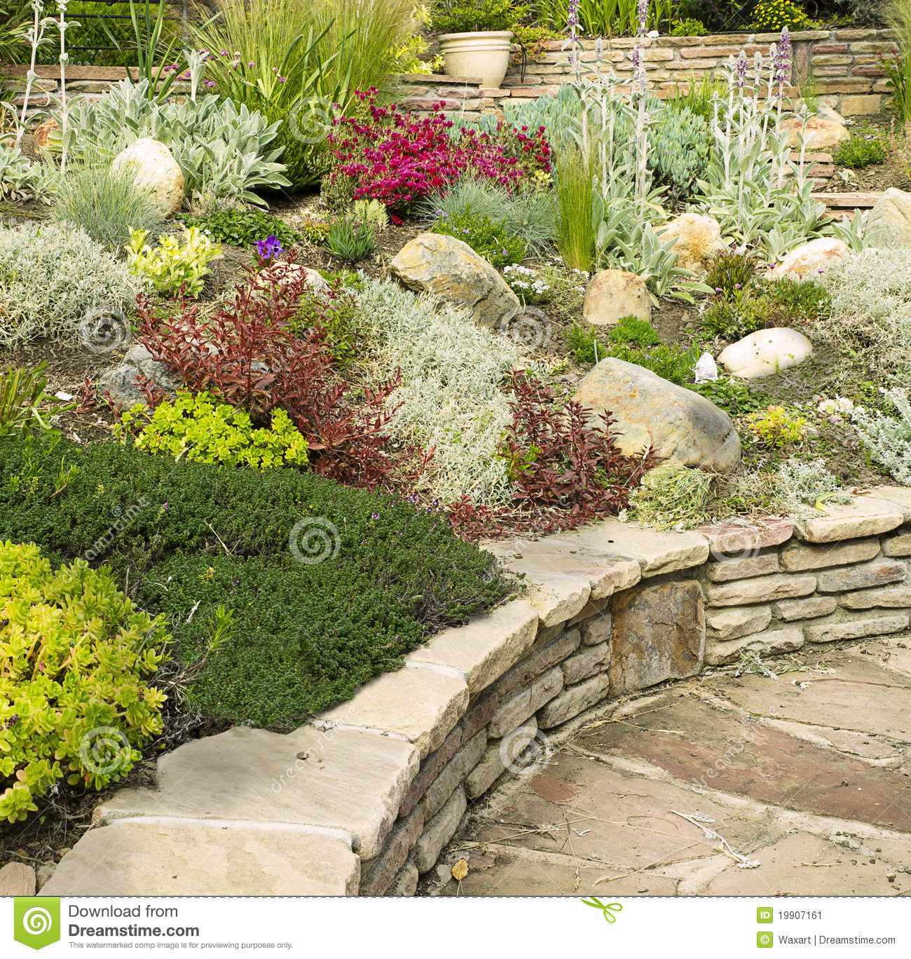 Colorful Rock Garden With Stone Wall Stock Image - Image: 19907161