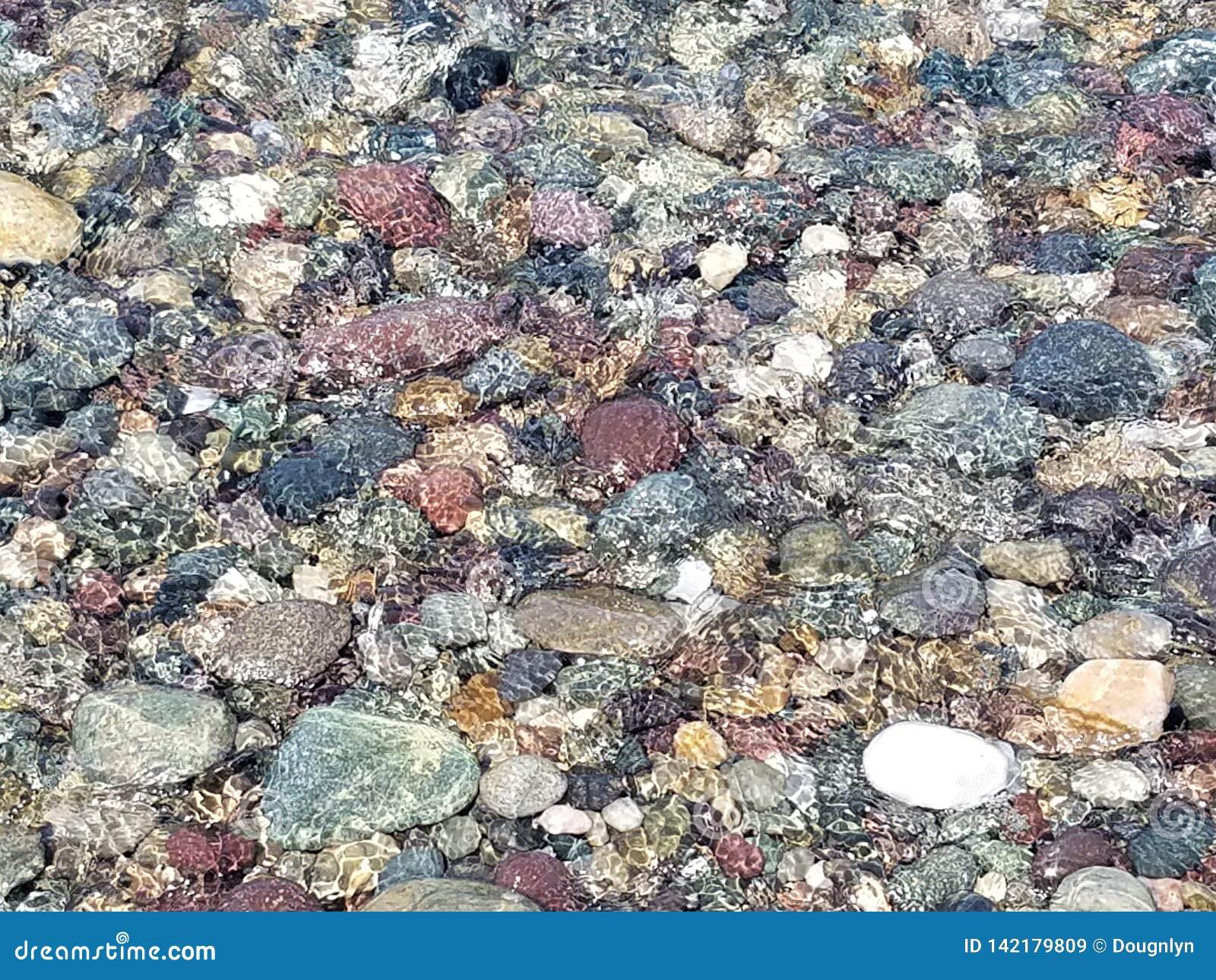 Colorful Rocks Under Ocean Surf New England USA Coastline