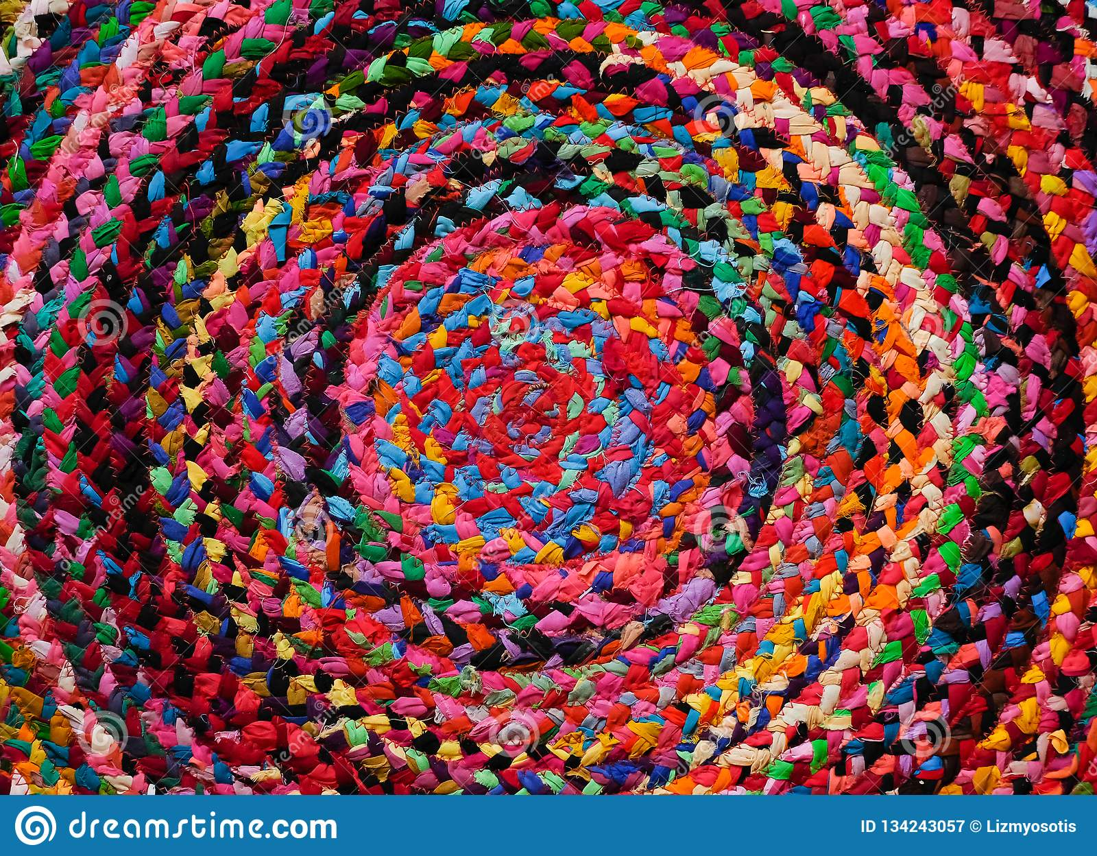 Colorful round african peruvian style rug or woven carpet surface close up. Ethnic and tribal motives. Bright accent in