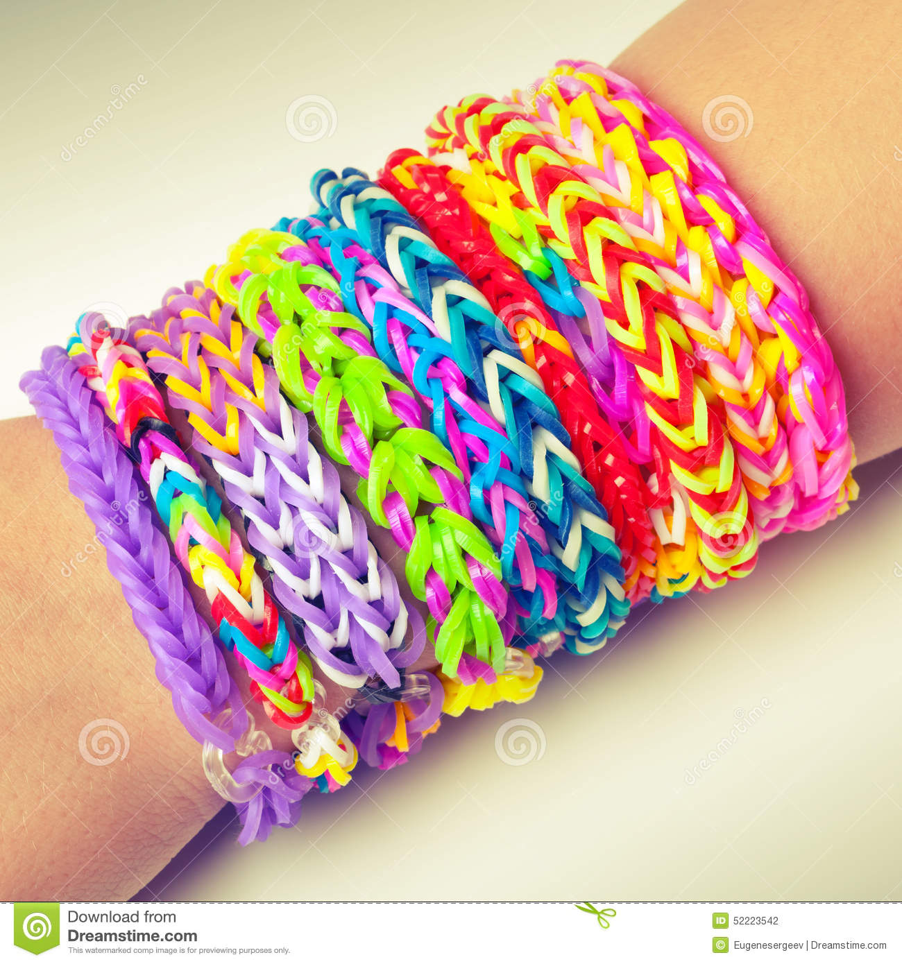 colorful rubber rainbow loom band bracelets on wrist stock photo image 52223542. Black Bedroom Furniture Sets. Home Design Ideas