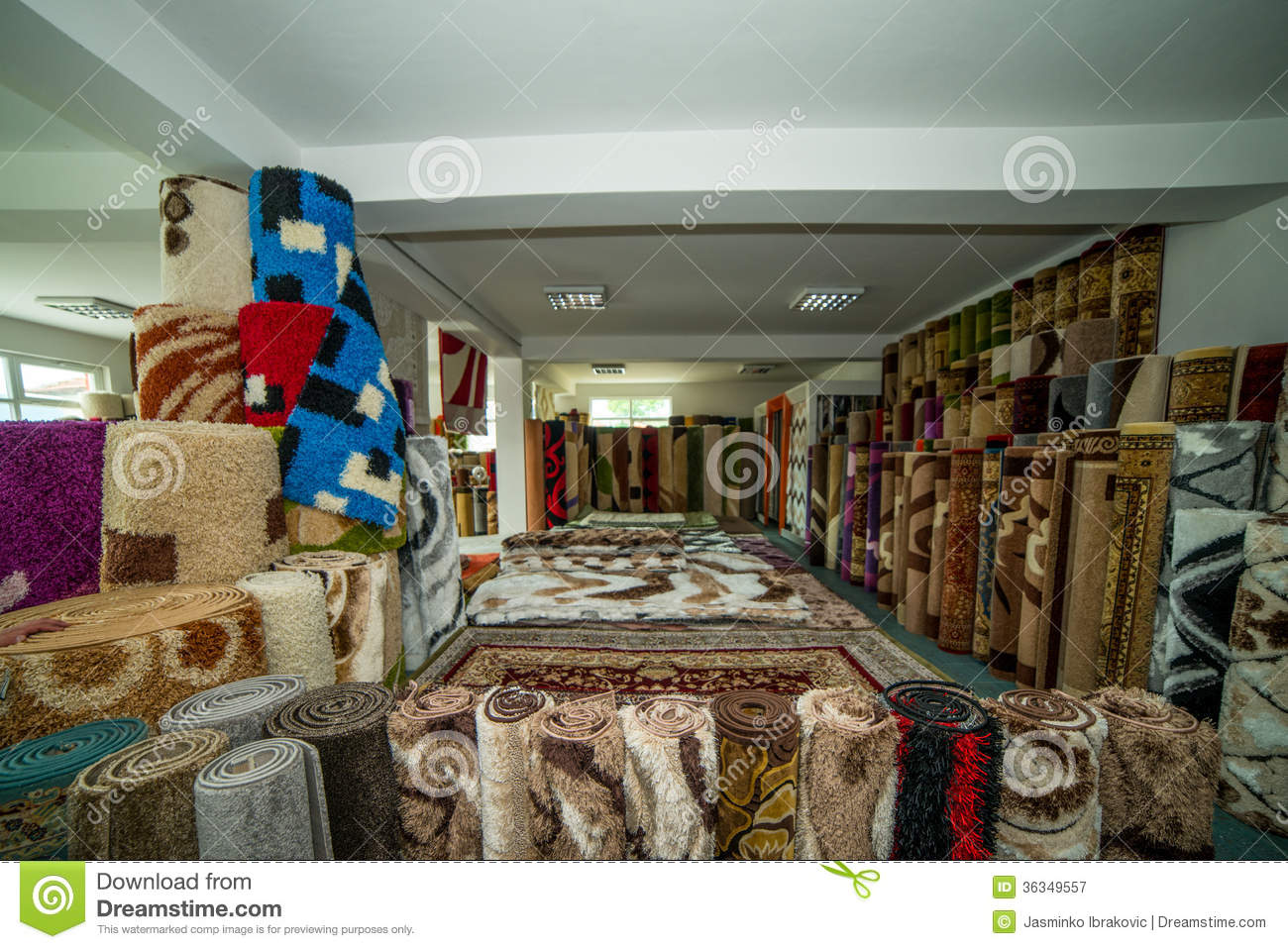 Colorful rugs for sale at store royalty free stock for Colorful rugs for sale
