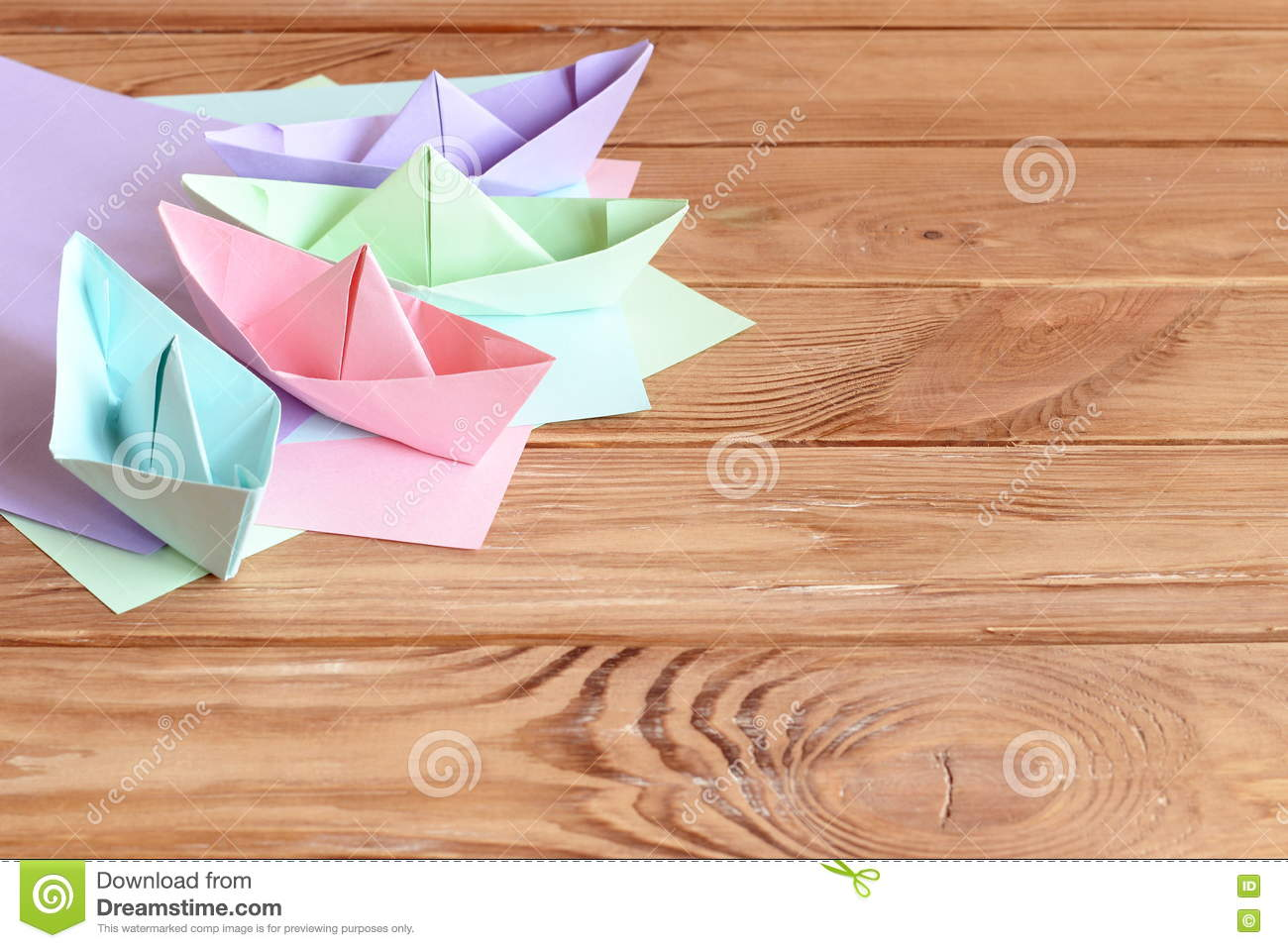 Download Colorful Ships Paper Folding Sheets Of Colored On A Wooden Table With Empty