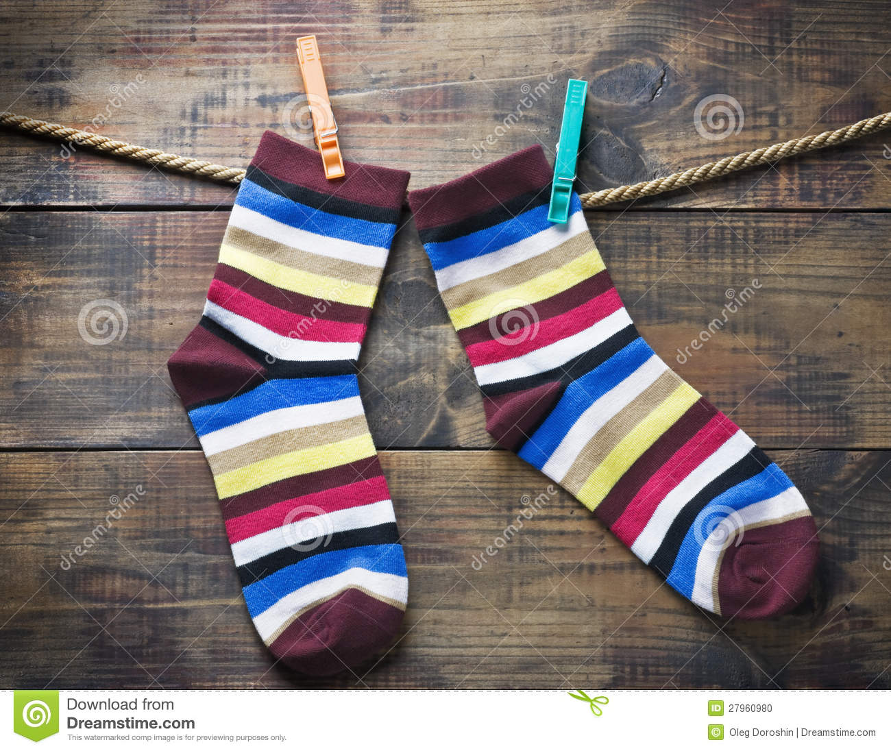 colorful socks hanging on clothespins stock photo image