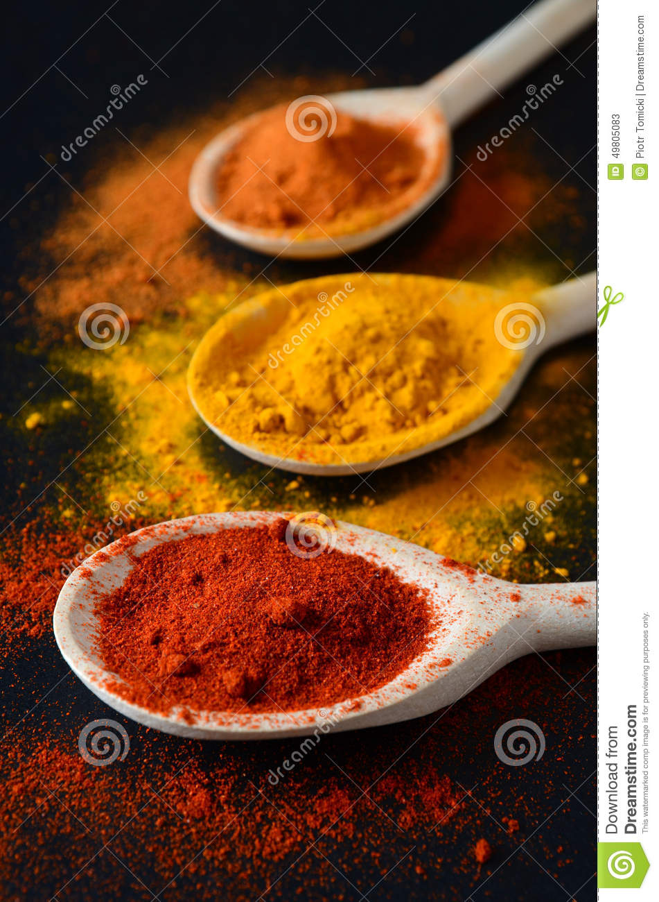 Colorful Spoons: Colorful Spices On Cooking Spoons Stock Image