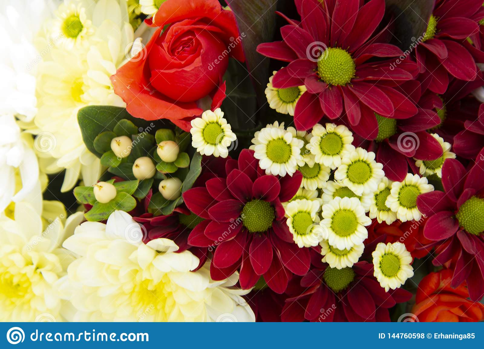 Colorful spring bouquet flowers with roses, chrysanthemum and camomile. Beautiful flower gift. Template for design. Copy space