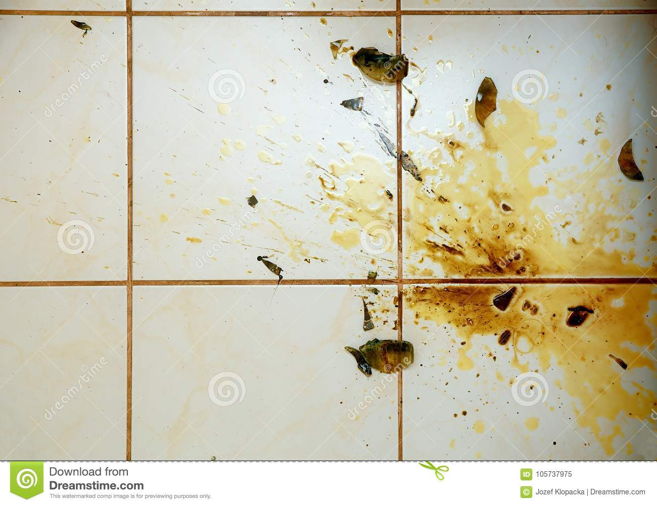 Colorful Stains And Broken Glass On White Bathroom Tiles. Stock ...