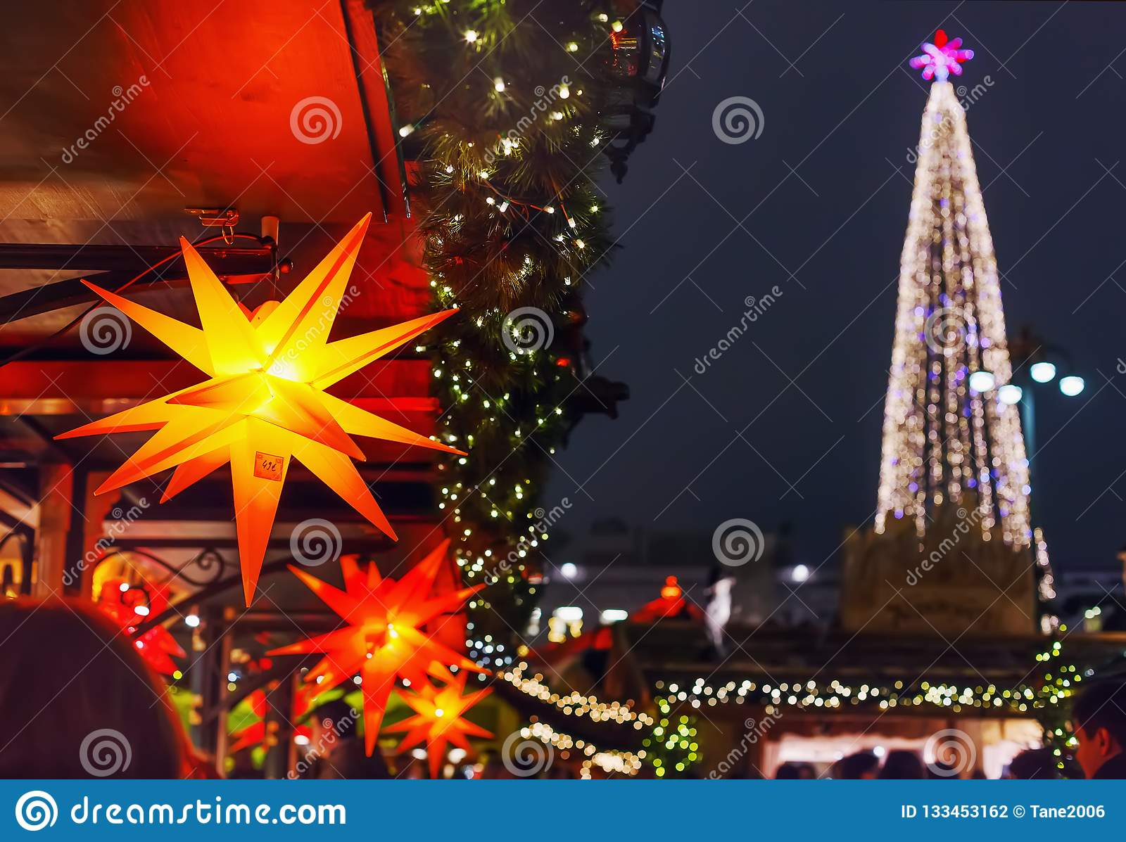 Colorful Stars For Sale And Lights Of Xmas Tree At A