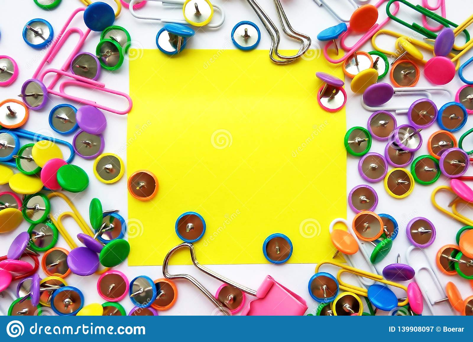 School and office supplies paper clips, pins, notes, stickers on white background
