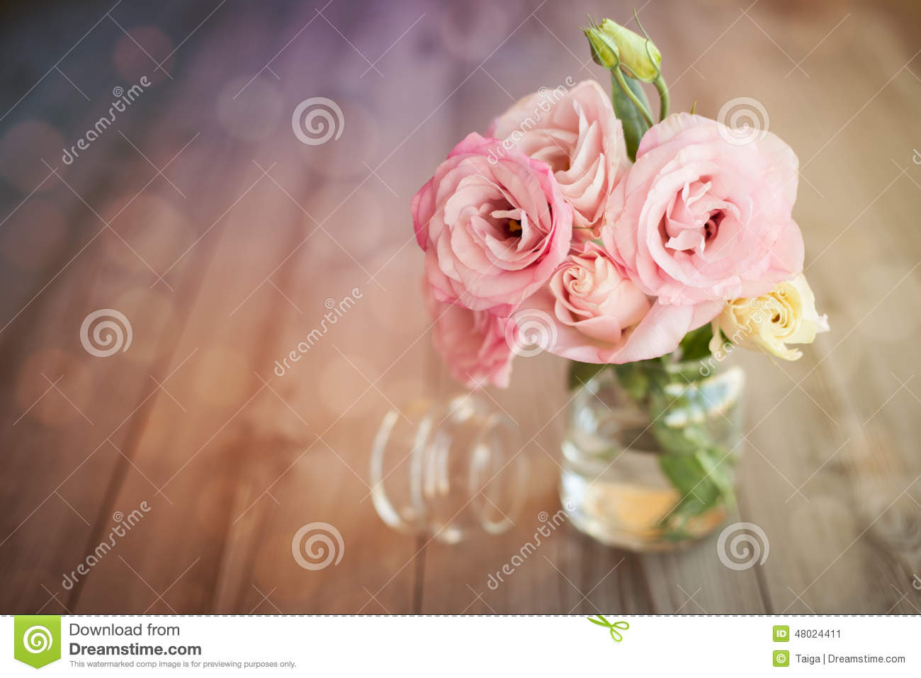Colorful still life with roses in glass vase