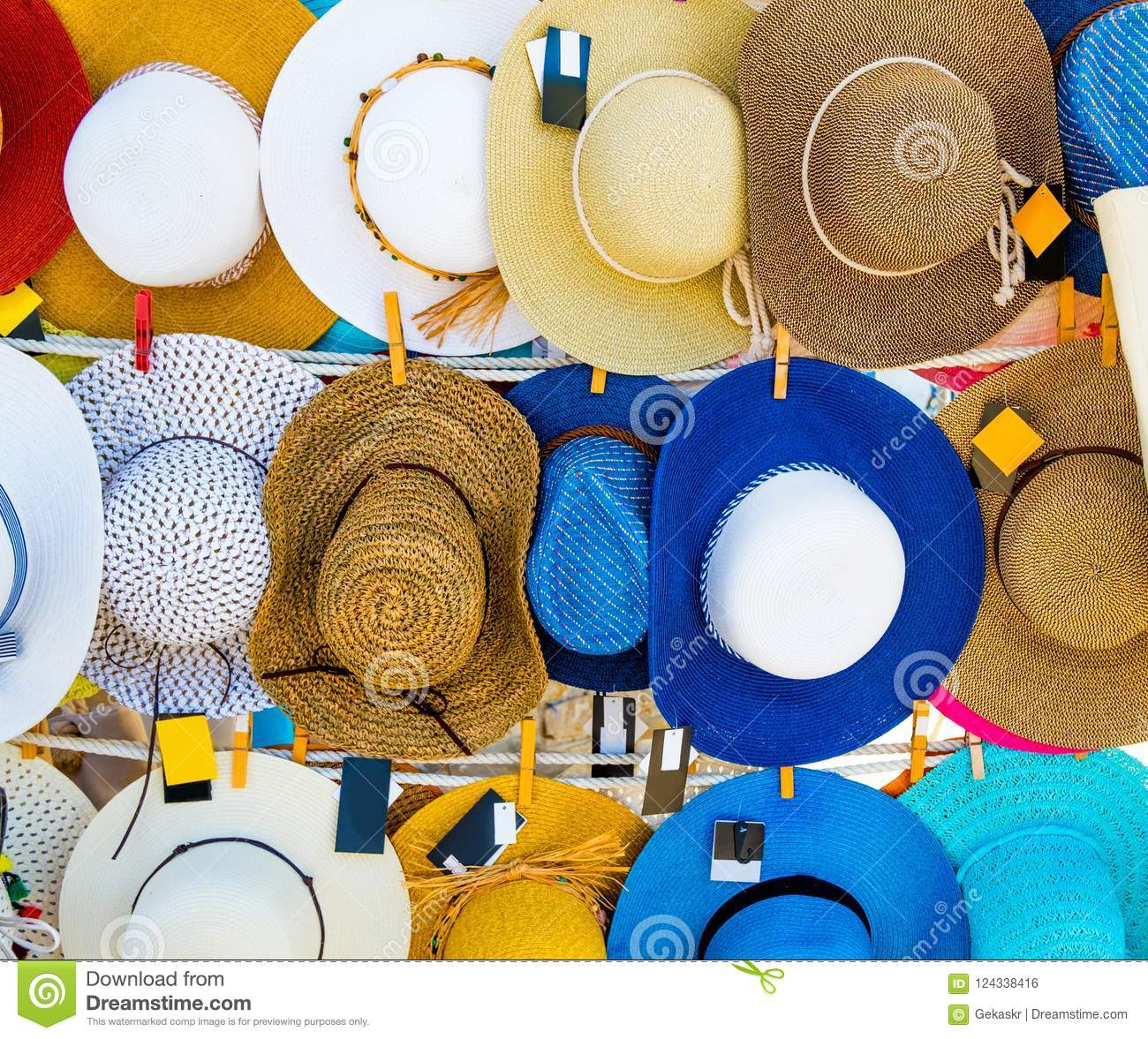 017151b9a0351 Colorful straw hats hanging on the market stall outdoor. Bright summer  woman hats for sale