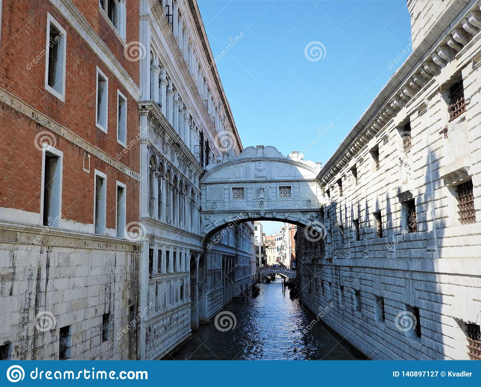 Colorful streets and canals of Venice on a clear day, Italy