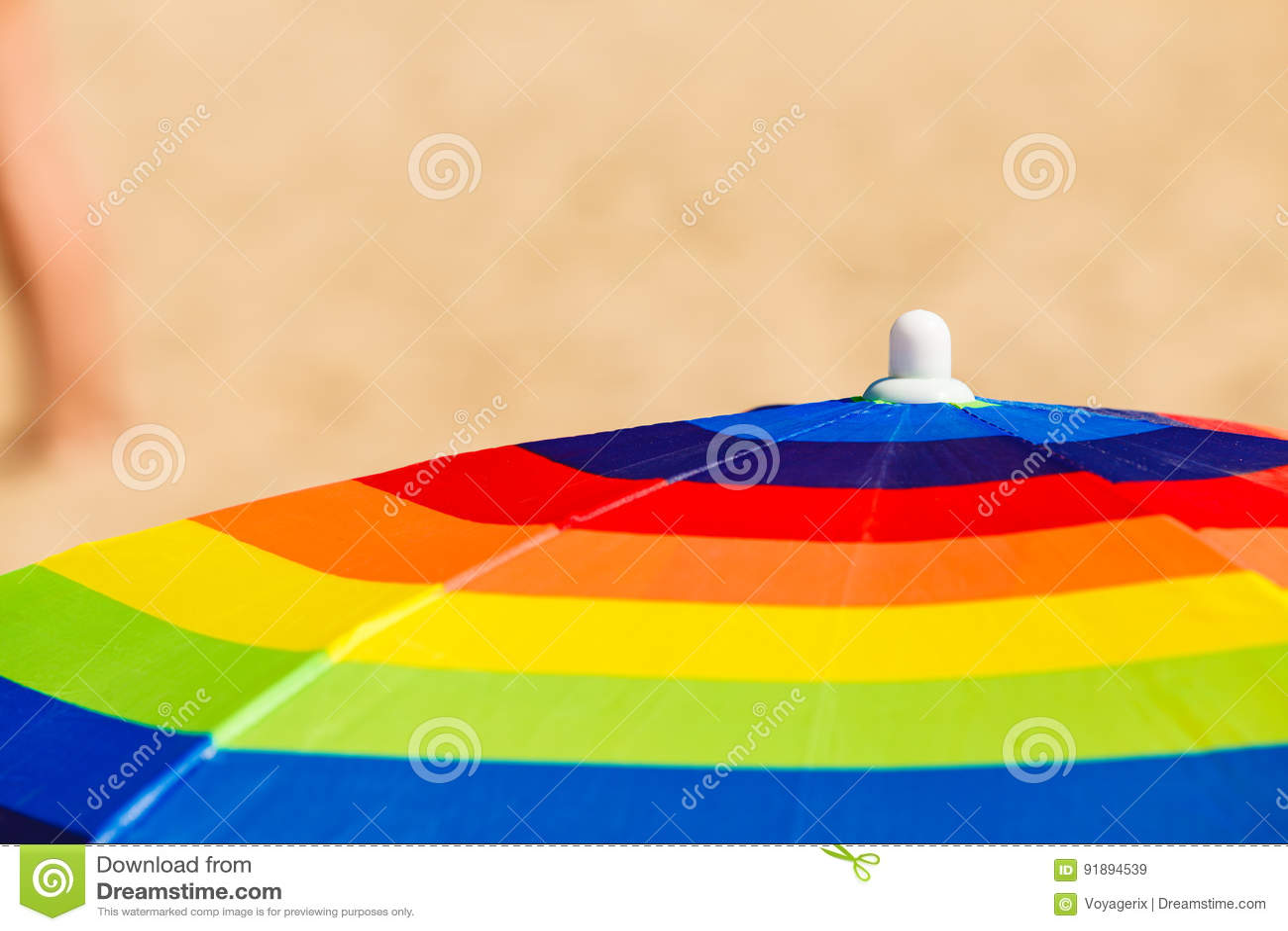 Colorful summer umbrella parasol during summertime