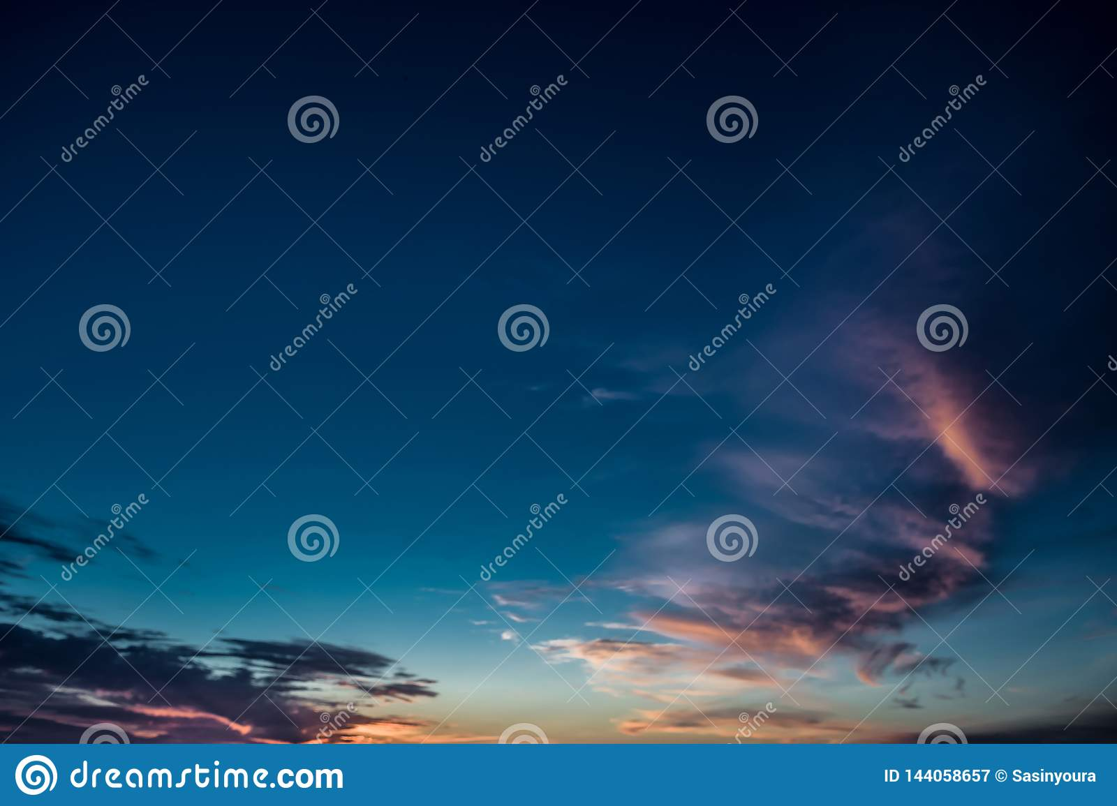 Colorful sunset sky over tranquil sea surface with dramatic light