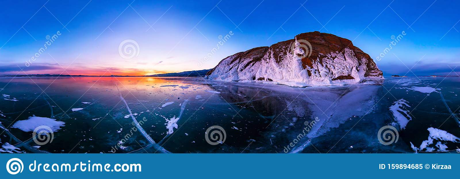 Colorful sunset on winter lake Baikal near an island covered with ice. . Cylindrical panorama 360