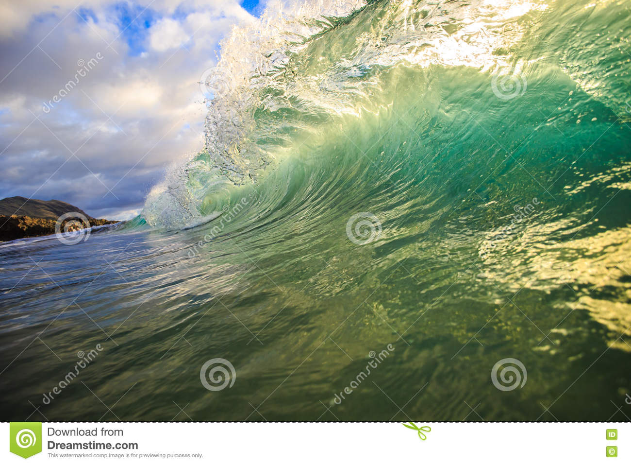 Colorful Surfing Wave Lit with sunlight in Oahu Hawaii USA