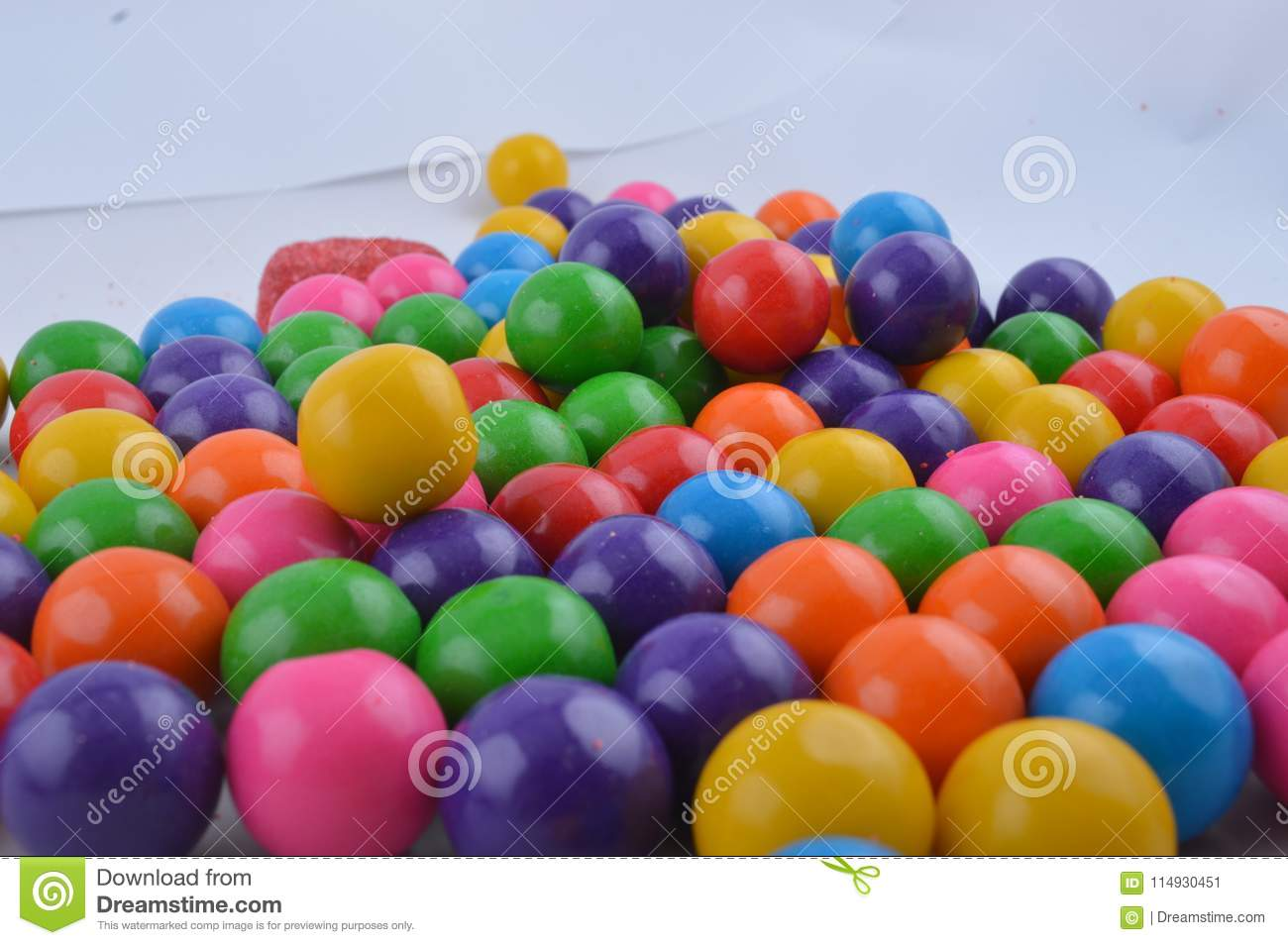 Colorful sweet gumballs thrown together