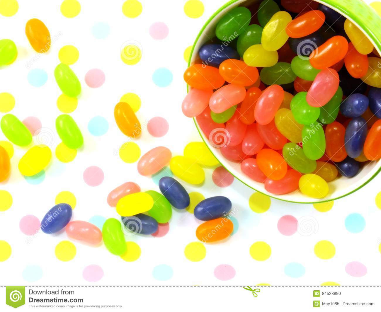 Sweet jelly beans top view on polka dot background