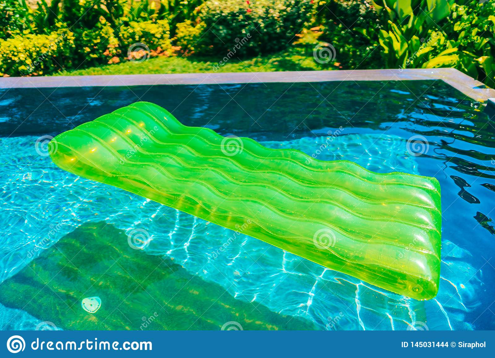 Colorful Swim Ring Or Rubber Float Around Swimming Pool ...