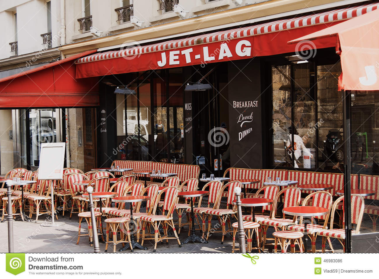 colorful tables and chairs in sidewalk cafe paris france editorial