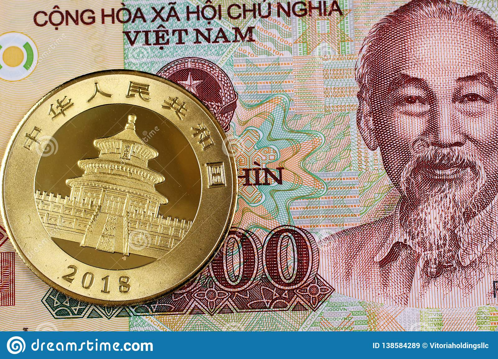 A Vietnamese Ten Thousand Bill With A Chinese Gold Coin Stock Image Image Of Metals Beijing 138584289