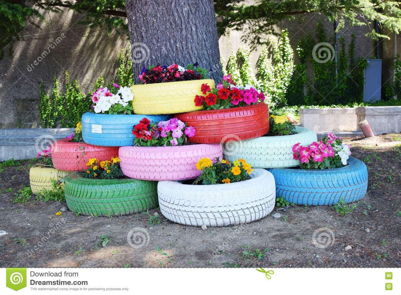 Colorful tires and flowers stock image image of concept for Puits decoration jardin