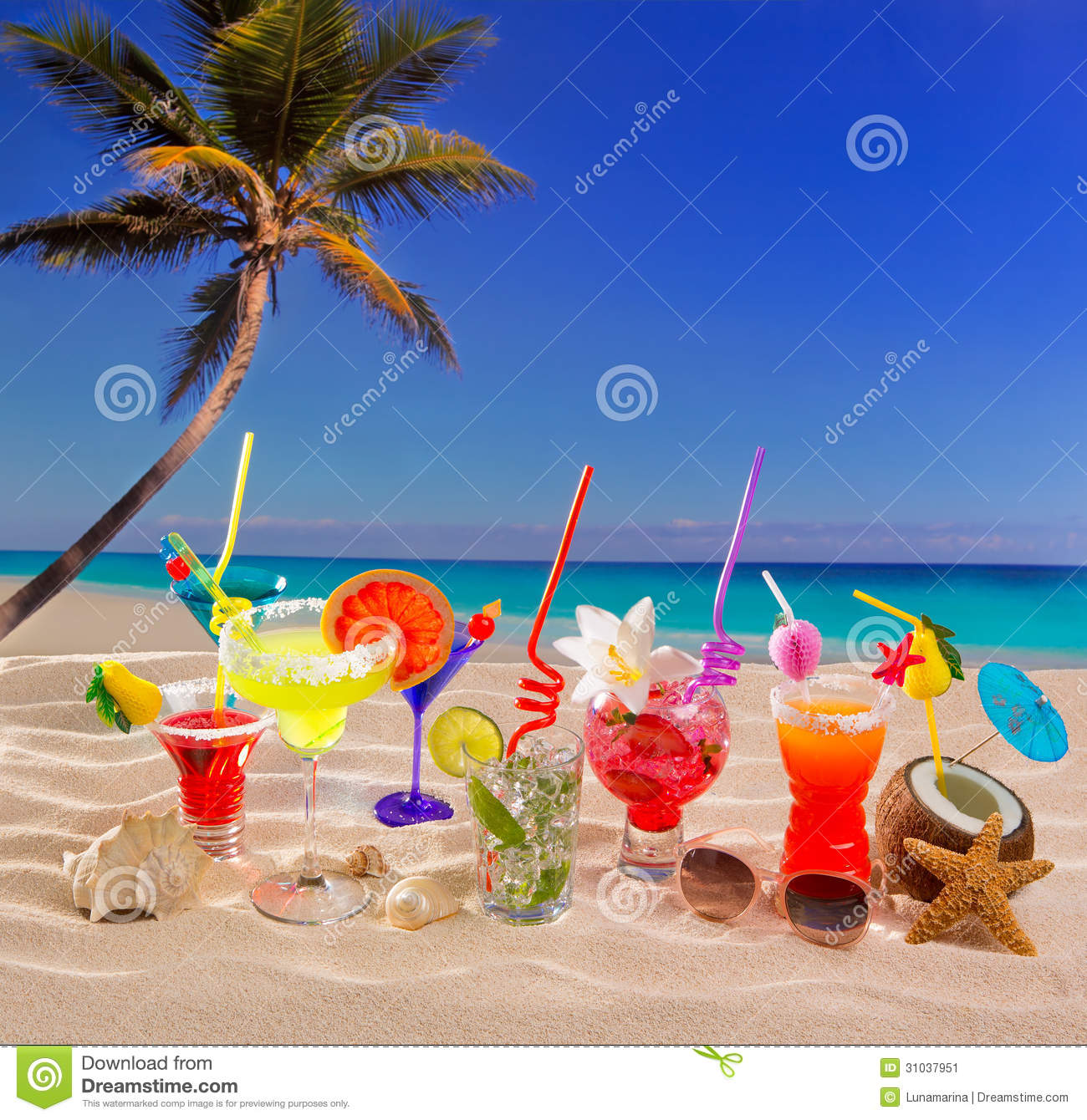 Colorful Tropical Cocktails At Beach On White Sand Stock