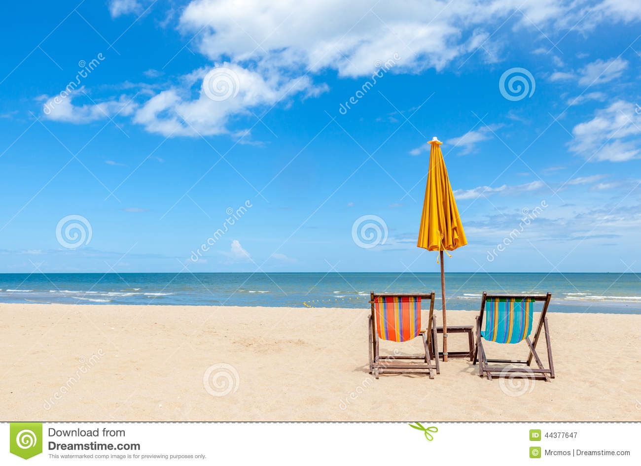 Colorful Two Beach Chairs With Sun Umbrella On Beautiful